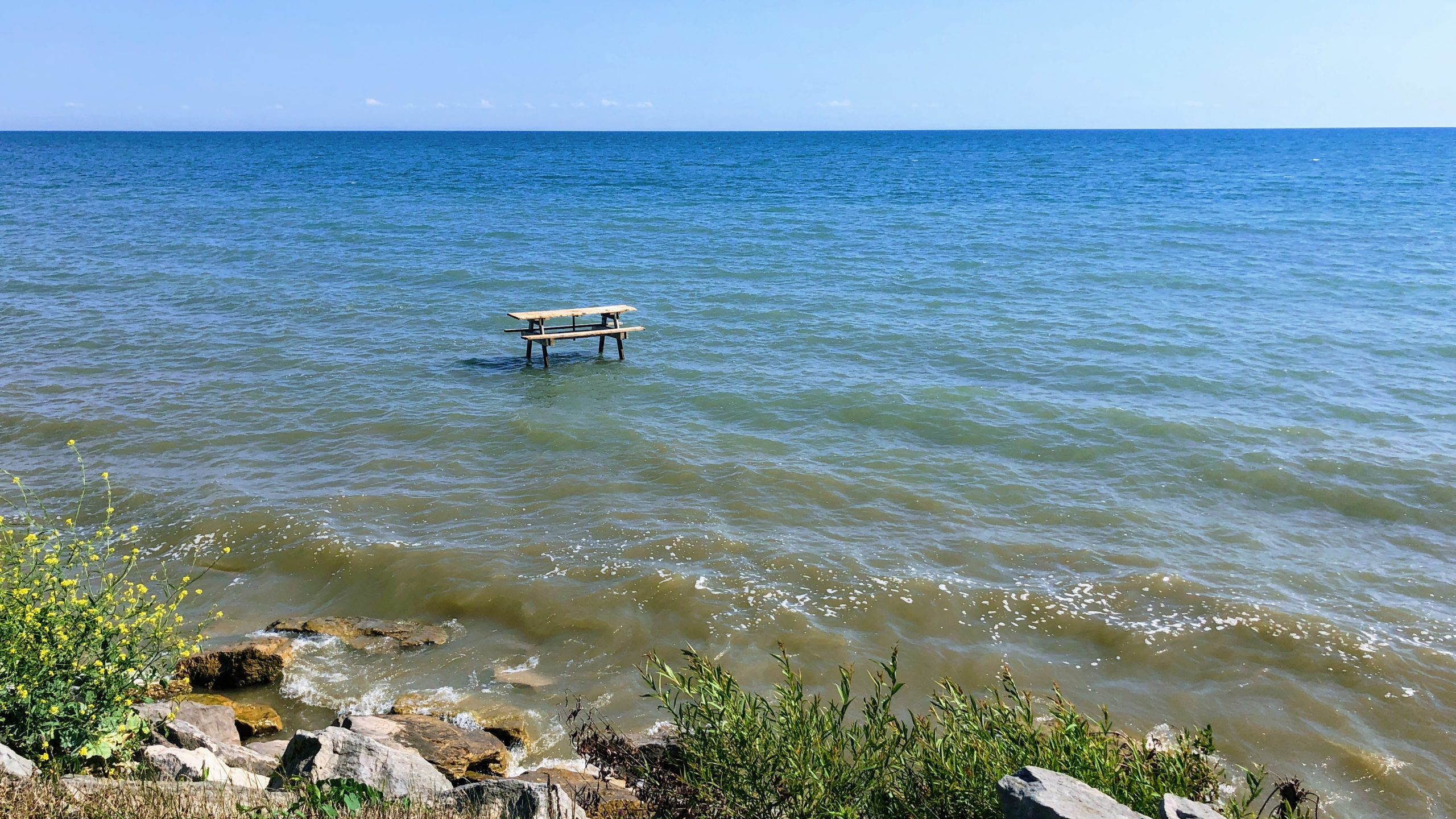 Picnic table in the water near Selkirk Provincial Park, along the Cannonball 300 bikepacking route.