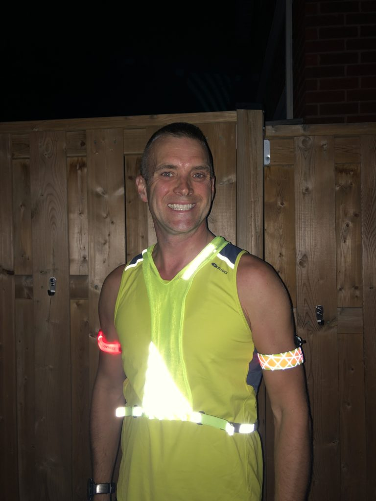 My setup for safe night running including two flashing arm bands, and a high visibility reflective vest.
