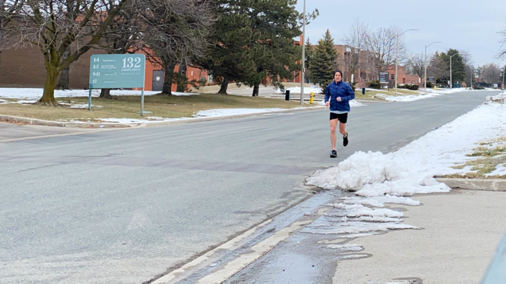 Photo of Me Running Down the Street in Shorts.